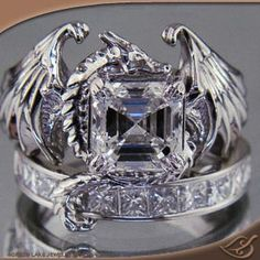 My Custom Jewelry Design at Green Lake Jewelry Works- Dragon ring with Asscher cut center stone, custom band below with tail of dragon wrapped around