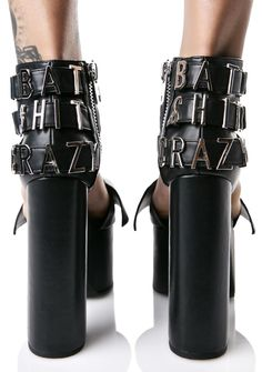 """Current Mood Bat Shit Crazy Heels are gonna have ya representing team cray-cray well. These epic platforms are constructed from a supa smooth matte vegan leather and feature a badazz bat wing toe strap and three stretchy ankle straps that read """"bat shit crazy"""" accross the back in silver colored letters. Compete with 6"""" chunky heels, 2.5"""" platforms and inner ankle zipper closure."""