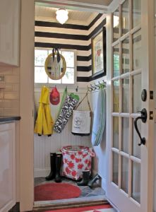 Liz Caan Interiors  small black and white striped mudroom design with beadboard & slate floors