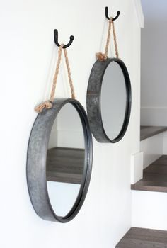 Iron Rope Mirrors Hung in Staircase - Tips for Hanging Art in the Stairwell #staircase #wallart