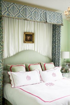I really am liking the looks of curtains at the head of a bed. Even if there's no window..
