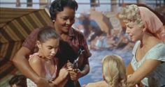 Imitation of Life (1959) Two mothers, Juanita Moore (Annie Johnson) and Lana Turner (Lora Meredith) join forces after a chance meeting on a beach to raise their daughters, Susan Kohner (Sara Jane) and Sandra Dee (Susie) while fulfilling their separate dreams of success.