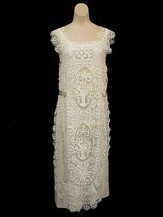 Hand-embroidered fine lawn dress, with panels of handmade needle lace and handmade filet lace, c.1924.