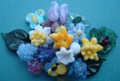 Kirsty makes the most delicious lampwork collections, her blossoms are adorable. Take a look at her teddy bear necklace. I own a lovely ocean necklace that stunning for summer...   http://www.kirstynarayglassarts.com/
