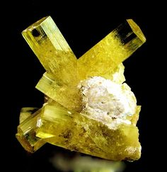 Tajikistan. Heliodor. This gorgeous crystal group comes from a very remote mine in the Tien Shan Mountains of this Central Asian country. Heliodor is a yellow gemstone variety of Beryl. Unlike its cousin, Emerald, this Variety of Beryl is often flawless in its natural state and is sometimes known as Golden Beryl. The colour is thought to come from a trace of iron in the chemistry.