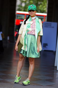 Streetpeeper.com Street Fashion Hat: Green and Silver Baseball Cap Jacket: Green and Gold Chinese Thing Top: Pink and Peach Print Shirt Skirt: Green Skirt Shoes: Neon Green NIKE Sneakers Photo By: Phil Oh