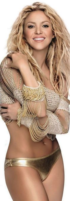 Shakira is rocking this look! Oh accessories are a must with our party wear ;) the Jamaican Girls are like C.O.G.I.C women when it comes to their accessories! lol...We will fit right in