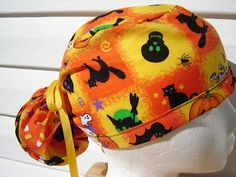$14.99 This is a great fun PONYTAIL scrub hat for Halloween. It is covered in fun Halloween things in Halloween squares. There are ORANGE P...