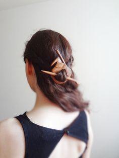 Neat idea! https://www.etsy.com/listing/94231128/witch-wizard-academy-hair-stick-shawl
