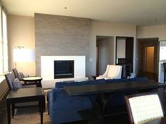 See the beautiful concrete fireplace surround paired with porcelain tile we recently installed.