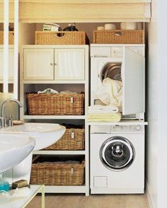 Tiny Laundry Room?  A stackable washer and dryer mixed with lots of baskets and shelves makes for a great small laundry room DIY space saving layout.