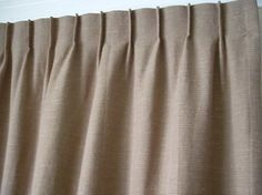 Single / pinch pleats - the pleats are achieved by making creases in the buckram (a stiff material used to make the heading). This heading achieves a flat-styled curtain, a relaxed look which takes up little room when drawn back, which allows maximum light in through your window while the curtains are open. The curtains hooks are placed directly into the back of the heading. Single pleats can be used on both tracks and poles.