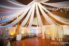 Twinkling Lights and Satin Chiffon ceiling drapery at Legacy Weddings #LakeLanierIslandsResort. Amore and John Atlanta Wedding | George Street Photo & Video