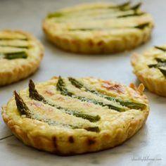 Tender asparagus, ricotta cheese, eggs and lemon in a flaky crust make this Asparagus Lemon Tartlete Recipe a flavorful dish to enjoy!