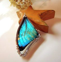 I've been sorta thinking that I want to get a butterfly necklace, one of these days...