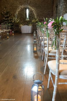 Winter wedding ceremony flowers, Christmas 2017 at Priston Mill by Bristol florists, The Wilde Bunch. A magical sparkling arch, crate stacks and aisle flowers in bottles. Winter Wedding Ceremonies, Wedding Ceremony Flowers, Wedding Table Centres, Pew Ends, Aisle Flowers, Stone Barns, Wedding Decorations, Table Decorations, Table Centers