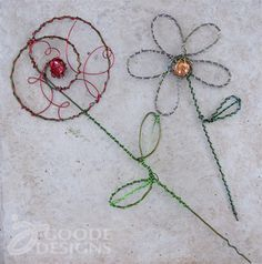 Pretty wire garden art you can make using clothing hangers and pretty gems… now I need more hangers!