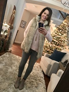 Fur Vest, Pink Sweater and Gray Jeans Outfit.  12 Cozy Winter Outfits + Where to Shop for Them http://getyourprettyon.com/12-cozy-winter-outfits-shop/?utm_campaign=coschedule&utm_source=pinterest&utm_medium=Alison%20Lumbatis%20%7C%20Get%20Your%20Pretty%20On&utm_content=12%20Cozy%20Winter%20Outfits%20%2B%20Where%20to%20Shop%20for%20Them
