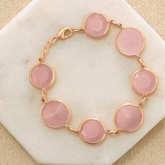Fabulous in Pink Bracelet. Avon. Nothing says flirty quite like a pop of pink! These rose-colored pieces are a perfect complement to today's feminine, romantic looks. Matte goldtone bracelet with round-shaped bezel set frosted pink stones. Regularly $19.99.  FREE shipping with any $40 online Avon purchase.  #CJTeam #Avon #Style #Sale #Jewelry #Fashion #C10 #Gift #Mom #MothersDay  #GiftSet #Bracelet #FabulousInPink #Avon4Me Shop Avon jewelry online @ www.TheCJTeam.com