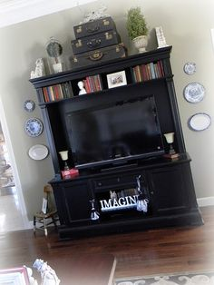 tv stand idea/ I really like the use of vertical space here.