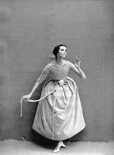 A model sporting a mauve velvet Dior evening dress for Harper's Bazaar, 1957. #vintage #fashion #1950s