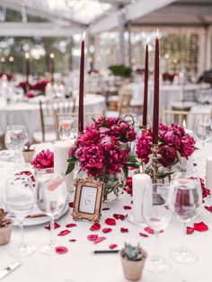Dark red peonies and vintage gold candlesticks | Image by Linas Dambrauskas