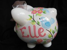 """Peresonalized piggy bank; """"Ellie""""; ask to replace light blue with more of an aqua color."""