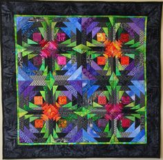 """Log Cabin Quilts: Dee Fractals Pineapple Quilt.  By Dee, """"This quilt was made using an offset pineapple block from Rich Traditions. It makes your eyes jump a bit but I enjoy looking at it. The quilt started out to be larger to get the circular effect of the pattern, but looking at it on the design wall, I decided it would be overwhelming if it were any larger."""""""