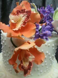 Orange Cymbidium Orchids.