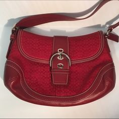 """Coach SOHO Small Signature Shoulder Bag In Excellent Condition!  Perfect Pop of Color to brighten up your Outfit. This has an adjustable Shoulder Strap w/ Coach Hangtag. Strap Drop is 8"""". Magnetic Snap Closure & Silver Hardware. One Interior Zipper Pocket, and Two Multifunction Interior Pockets. Slip Pocket on Back. EXTREMELY CLEAN!!! Coach Bags Shoulder Bags"""
