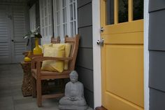 Grey siding and yellow front door
