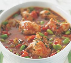 Slow cooker chicken stew.Chicken breasts with vegetables and spices in slow cooker.