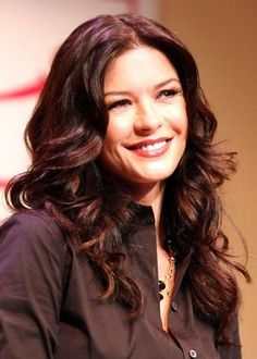 Catherine Zeta-Jones.....I think she's beautiful.  She's Welsh, and so am I....probably the celeb that I get told I look like the most.  I think I'll take that as a compliment!! <3