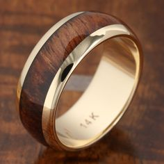 14K Yellow Gold Natural Hawaiian Koa Wood Inlaid Wedding Ring 7mm Item Number: GKR6001 Material: 14K Yellow Gold and Koa Wood Band Width: 7mm Weight: approximately from 4.5 gram to 7 gram depend on th