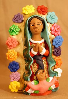 Guadalupe with Flowers |  This delightful image of the Virgen de Guadalupe comes from the workshop of Josefina Aguilar of Ocotlan Oaxaca Mexico.