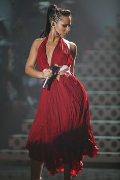 Alicia Keys looking dazzling in red during her performanceat the Brit Awards on February 17, 2004. Photo Credit: JMEnternational, RedFerns/Getty Images  via @AOL_Lifestyle Read more: https://www.aol.com/article/2013/01/23/girl-fire-best-alicia-keys-signature-stage-ensembles/20504411/?a_dgi=aolshare_pinterest#fullscreen