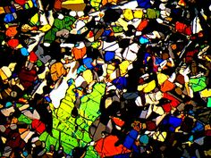 Agoult meteorite thin section viewed through cross polarized light under a microscope