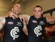 Chris Judd (L) and Mitch Robinson of the Blues celebrate in the rooms after the round three AFL match between the Carlton Blues and the Collingwood Magpies at Melbourne Cricket Ground on April 13, 2012 in Melbourne, Australia.