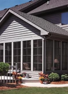 EZE Breeze Porch Windows looks like a permanent part of the house because if the details below the windo. Not right to ground Four Seasons Room, Three Season Room, Indoor Outdoor Living, Outdoor Rooms, Porch Enclosures, Porch Windows, Sunroom Addition, Outdoor Patio Designs, Screened In Patio