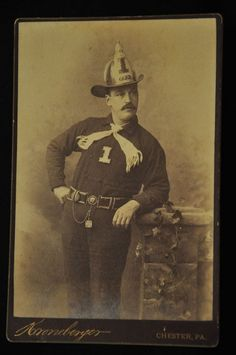 "1870-1900 Fire Man/Dept. Cabinet Card - F.W.H. Helmet - Hose Co.1     The photographer is Kronebesyer of Chester, Pennsylvania.  Details - helmet has letters F.W.H. (Fort Wayne Hose) or for a Fire Department in or near Pennsylvania.  Appears he was a Lieutenant from the letters across top of his helmet shield.  Belt buckle has a ""H"" most likely for Hose Company assignment. Classic mustache & fireman swagger. Original w/ photographer's name embossed in lower right corner   SOLD $71.00"