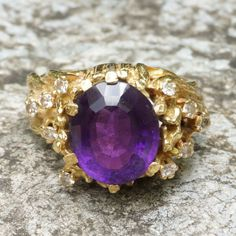 1970s retro 18ct gold amethyst and diamond ring by GemcircusJewelry on Etsy https://www.etsy.com/listing/471590441/1970s-retro-18ct-gold-amethyst-and