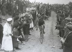 1933 Tour de France winner Georges Speicher as he pedals over the gravel and through the throngs of spectators. (xxc magazine)