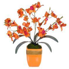 Faux orchid arrangement in a ceramic pot.     Product: Faux floral arrangementConstruction Material: Ceramic