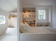 <p>This duo of book-nook beds utilizes a small space well. A simple dividing wall creates a headboar... - Design by Sullivan Building & Design Group; photography by Kathleen Connelly