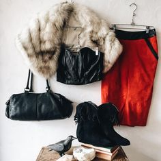 """This one's for all you red hot leather mamas! // Michael Hoban for North Beach Leather black leather 90's bustier with zipper back. 30"""" bust 9"""" long. $138. // Softest grey rabbit fur stole that can be worn on the shoulders with light grey lining hook and eye closure monogrammed with """"BJA"""" on inner left side. $138. // Karen soft and thin suede pencil skirt with black leather waistband and trim at pockets. 26"""" waist 26"""" long. $72. // A's classic black suede low flat cowboy boot with fringe…"""