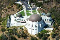 Griffith Park Observatory--LA with a view point of the Hollywood sign. Seriously, the coolest space museum in the world. I'm going to have to go back at night so I can actually see the stars with the HUGE telescope there. If you have kids, take them, it's very interactive!! I loved it!!