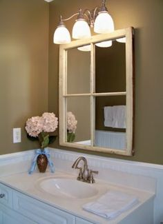 A homeowner submitted this image of a re-purposed window from her grandfather's childhood home that she turned into a mirror. It attractively compliments the sculptural feeling of the Virtue faucet for a fraction of the cost of a store bought 'distressed' mirror. ***Virtue Centerset Faucet