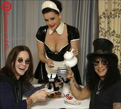 """Santino & Co Walking Pottery Studio Ware. Pictured is a very happy Ozzy Osbourne and Slash enjoying their favourite cuppas. Ozzy's got his hands around the walking Policeman """"On Patrol"""". Slash is holding the """"Prisoner On The Run Cup""""...Hand-made and hand-painted in limited edition production runs. Put a smile on your face in a new, fun way to start your day!  Santino & Co's Walking Pottery...  Making today's collectables..... tomorrow's antiques...."""