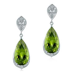 18ct white gold earrings set with a pear shaped peridot and grain-set diamond bottom with a pear shaped diamond set at the top.