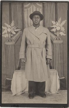 Souvenir Photograph of a Black Man in a Trench Coat with a Wonderful Naive Backround | Flickr - Photo Sharing!